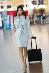 indian businesswoman talking on mobile phone