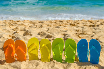 Fototapete - Colorful flip flops on the sandy beach