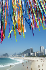 Rio Carnival celebration features colorful Brazilian lembranca wish ribbons at Copacabana Beach
