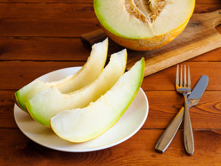 Fresh juicy melon on a wooden table background