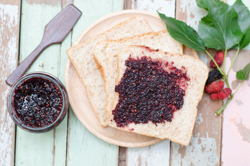 breakfast : home made bread with mulberry jam on wooden table