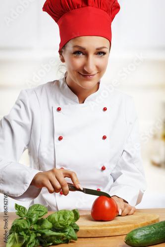 """Frau beim Tomate schneiden"""" Stock photo and royalty-free images on ...   {Köchin bei der arbeit 56}"""