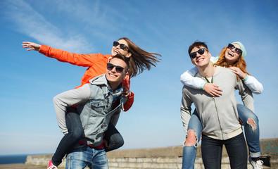 happy teenage friends having fun outdoors