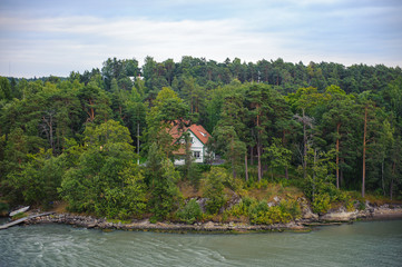 House among the trees in Finland small islands near Turcu