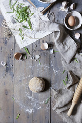 fresh dough on wooden table for the preparation of a savoury pie