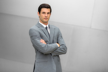Strong handsome confident business man portrait posing with successful posture and pose in a fashionable suit
