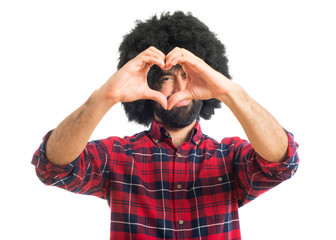 Afro man making a heart with his hands