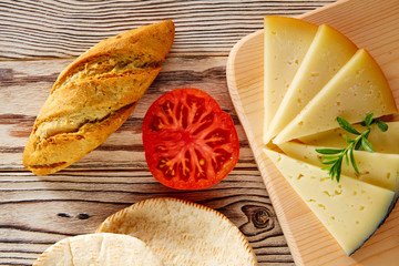 Mediterranean food bread loaf tomato and cheese