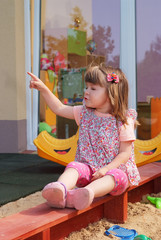 Two-year girl playing and learning in preschool