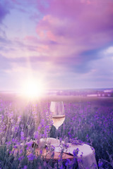 Wine glass against lavender.