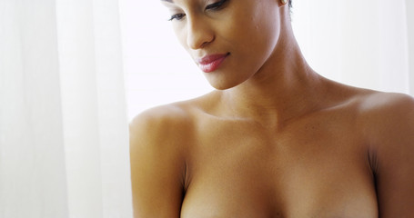 Sexy topless black woman  looking out woman