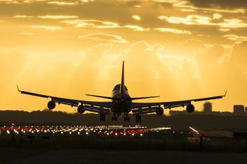 Tuinposter Huge plane is landing on the runway.