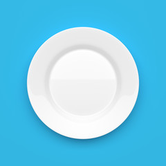 Empty white ceramic round plate on blue