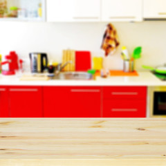 Empty wooden desk and defocused modern kitchen for product display montages