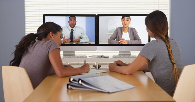 Professional team of multi-ethnic business colleagues having a video conference
