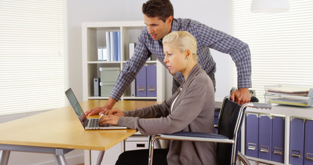 Two business colleagues working at desk