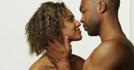 Happy black couple kissing