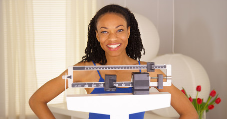 African woman feeling very proud of herself