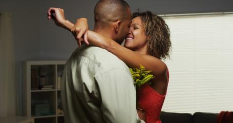 African boyfriend surprises girlfriend with flowers