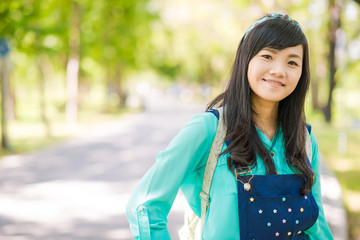 Young woman smiling look at camera outdoors