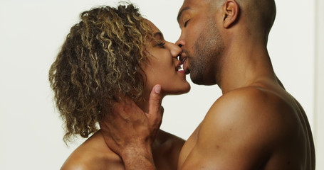 Happy black couple kissing