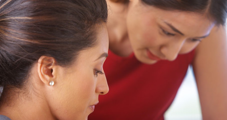 Multi-ethnic businesswomen talking