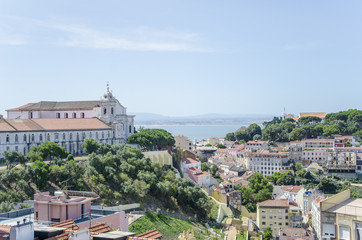 Lisbon rooftops view and church