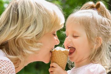 Happy mother and baby enjoy ice cream