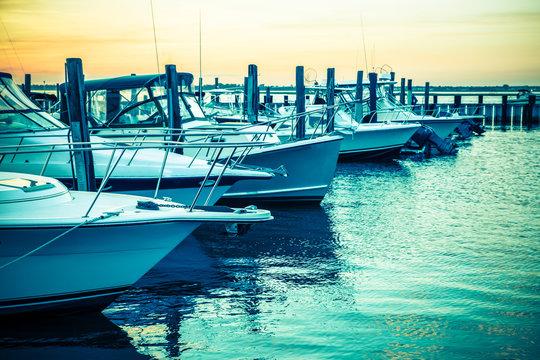 Colorful sunset toned boats docked at marina