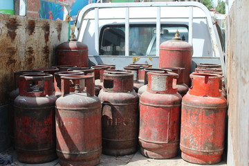 Old red gas cylinders. High pressure propane or LPG gas cylinders.