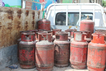 Old red gas cylinders.