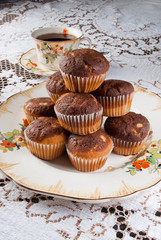 Classical tea time with tasty muffins over retro ambient with porcelain dishes.