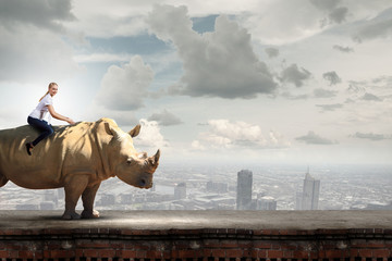 Wall Mural - Woman ride rhino