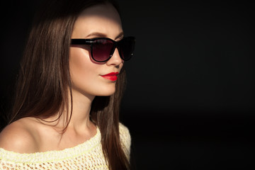 Beautiful young model with sunglasses.
