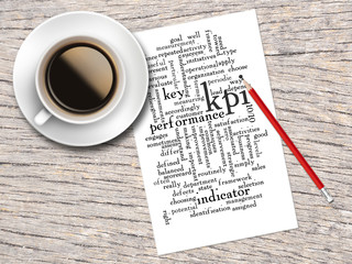 Coffee, Pencil And A Note Contain Word Clouds Of KPI And Its Rel