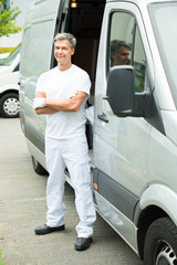 Painter With Arms Crossed In Front Of Van