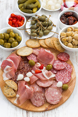 Assorted meat snacks, sausages and pickles, top view