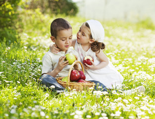 Children eating apples i nature