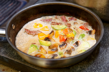 Meat and vegetables cooked in cream
