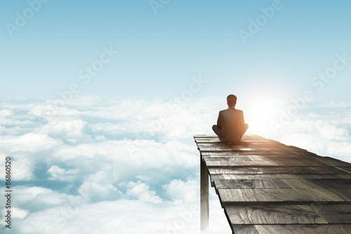 Fototapete businessman sitting on pier