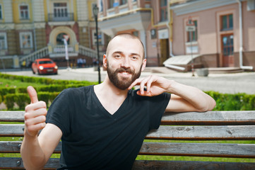Cheerful young man with beard and positive emotions
