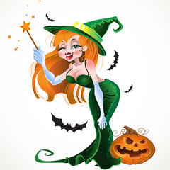 Cute sexy witch in green dress with the magic wand and pumpkin