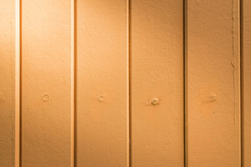 beautiful vertical orange color wood background texture with lig