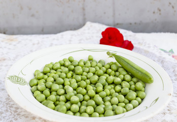 Green peas on the white plate background