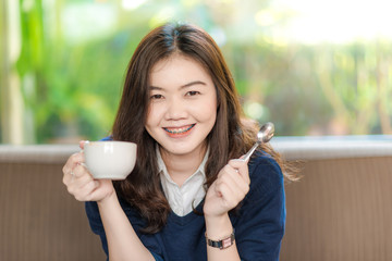 Young Business asian smiling woman Having a Coffee Break.  Close