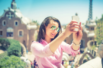 Attractive woman takin selfie with smart phone, mobile phone. Modern concept of photography, selfie, beautiful woman taking pictures of herself