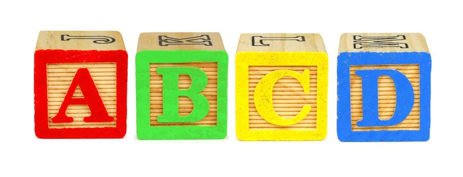 A B C D wooden toy letter blocks isolated on white