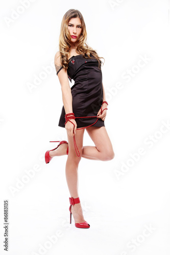 Sensual Girl With Short Black Dress And Red Shoes And Jewelery
