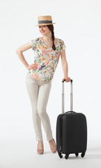 Happy vacation! Playful smiling young woman  with suitcase