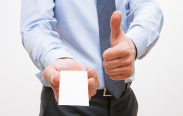 Unrecognizable businessman showing  visiting and thumb up sign